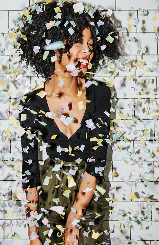 Portrait of a Beautiful black woman with confetti  by kkgas for Stocksy United