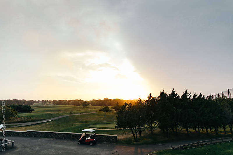 Beautiful golf course as the sun is going down by Eddie Pearson for Stocksy United