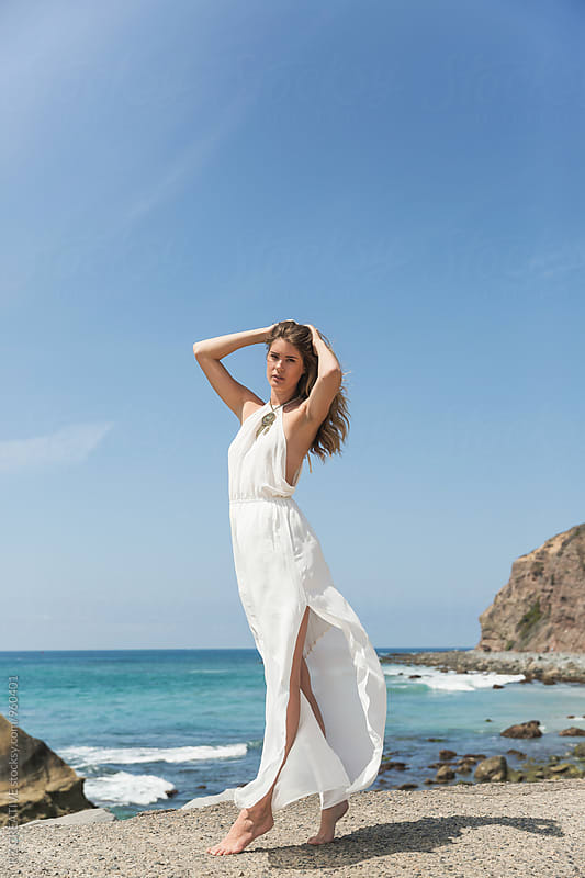 Young woman in white dress on the beach. by RZ CREATIVE for Stocksy United