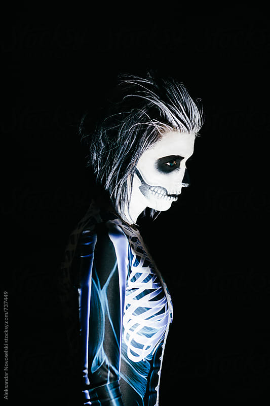 Woman with skeleton costume and halloween make up on black by Aleksandar Novoselski for Stocksy United
