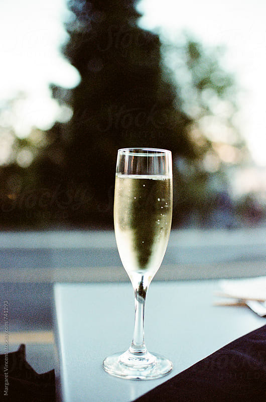 a simple and beautiful glass of bubbly by Margaret Vincent for Stocksy United