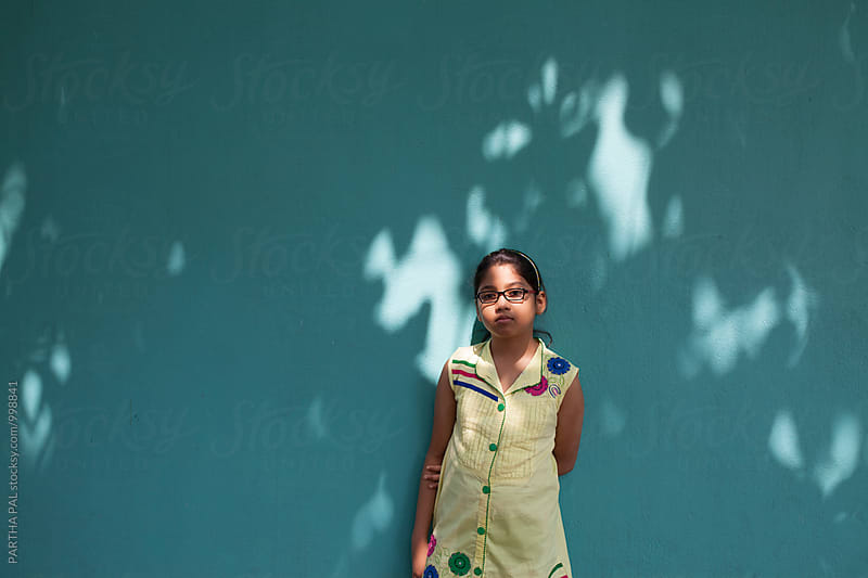 A girl Against Shady Background by PARTHA PAL for Stocksy United