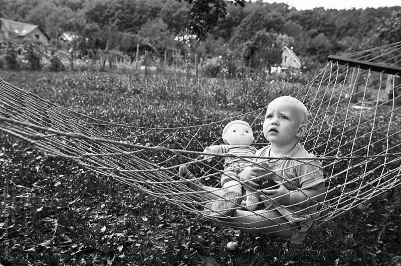 Little girl  in a hammock. by Svetlana Shchemeleva for Stocksy United