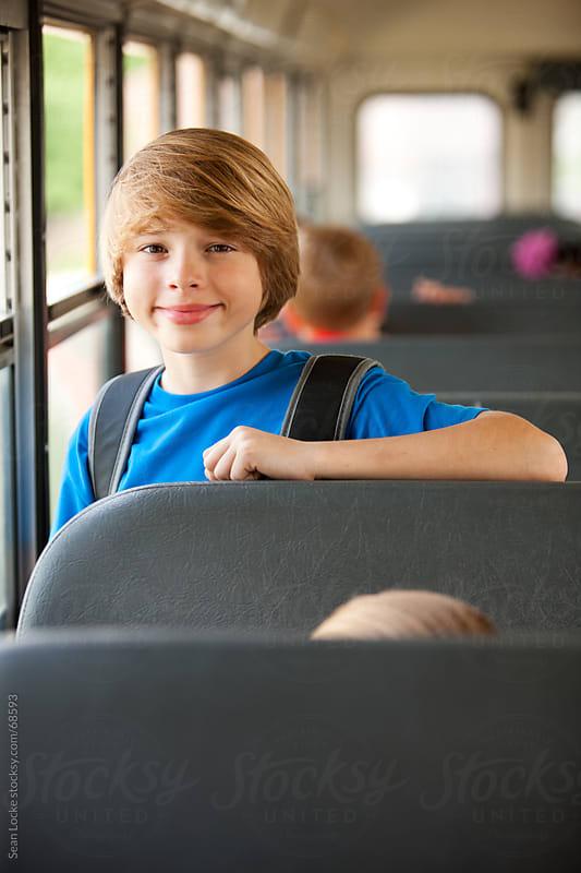 School Bus: Handsome Schoolboy on the Ride to School by Sean Locke for Stocksy United