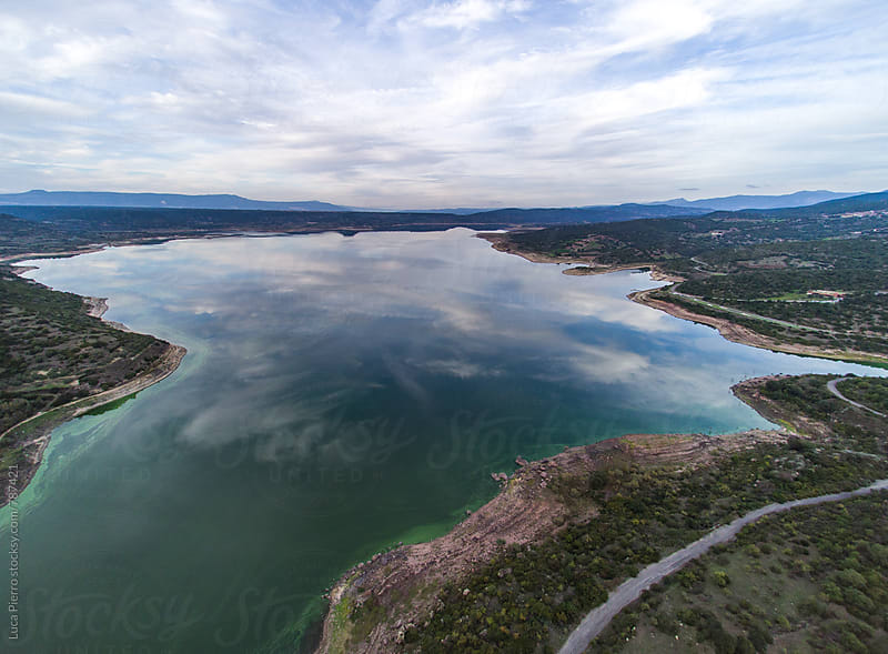 Aerial view of a lake by Luca Pierro for Stocksy United