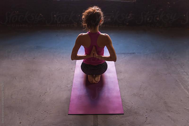 Rear view of fitness woman doing yoga in reverse prayer pose. Pashchima Namaskarasana  by Jovo Jovanovic for Stocksy United