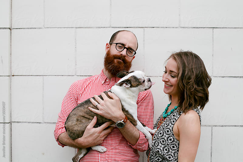 Couple with their dog  by Jennifer Brister for Stocksy United