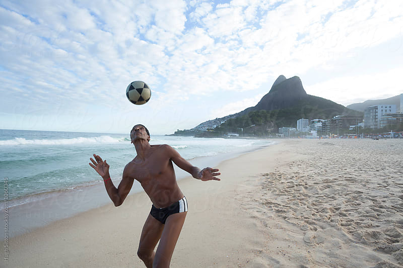 Brazilian man with soccer ball. Ipanema. Rio.  by Hugh Sitton for Stocksy United