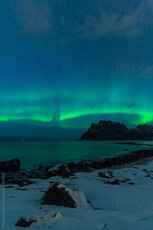 Aurora over Uttakleiv II by Marilar Irastorza for Stocksy United