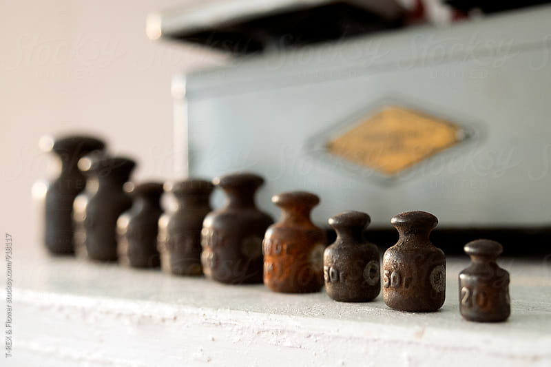 Nine rusty iron weights in row by Danil Nevsky for Stocksy United