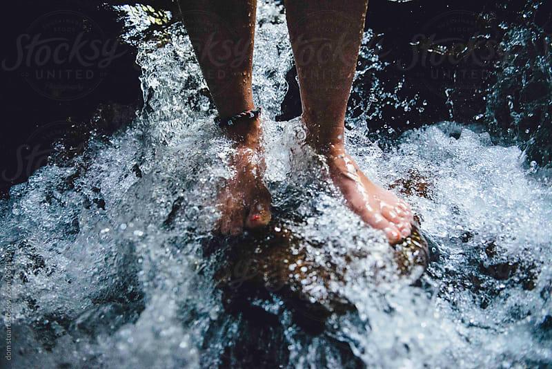 Feet In Waterfall by dom stuart for Stocksy United