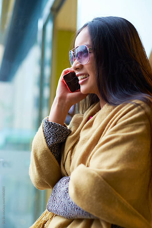 young woman talking on the phone by Bo Bo for Stocksy United