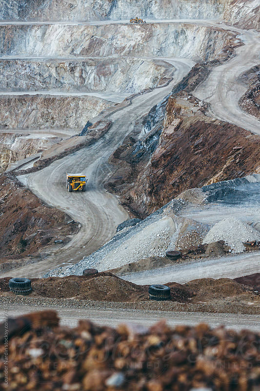 yellow quarry truck in strip mining area by Leander Nardin for Stocksy United
