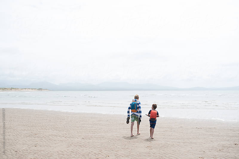 kids walking on the beach by Léa Jones for Stocksy United
