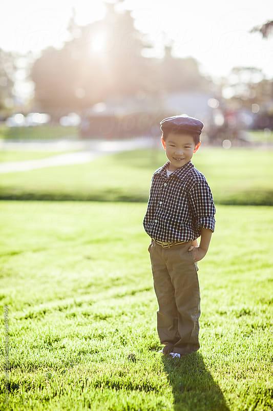 Asian kid portrait outdoor by Suprijono Suharjoto for Stocksy United