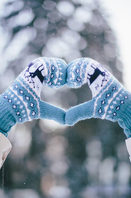 Hands in mittens making heart symbol by Andrey Pavlov for Stocksy United