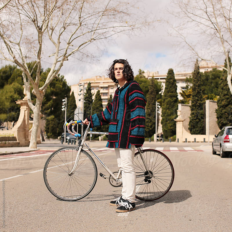Bohemian young boy with a bike by Lucas Ottone for Stocksy United