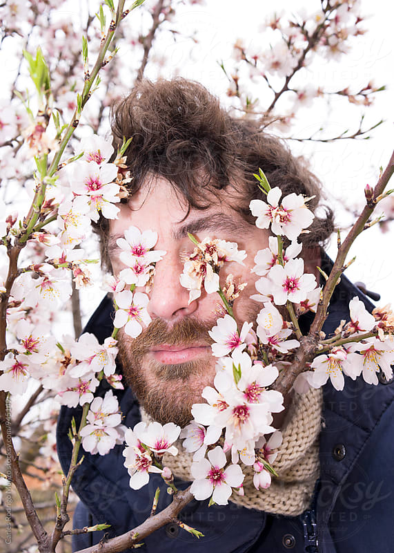Man and almond flowers by Carles Rodrigo Monzo for Stocksy United