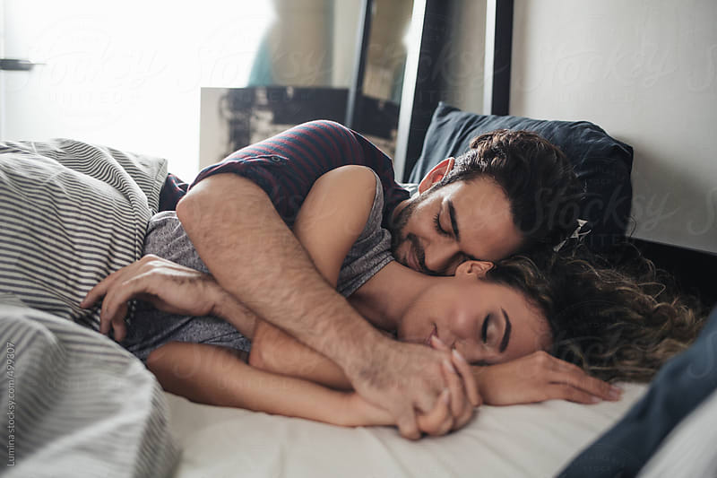 Young Couple Sleeping in Bed by Lumina for Stocksy United