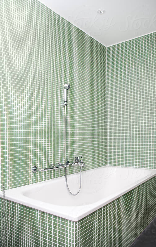 Bathtub with Shower by Julien L. Balmer for Stocksy United