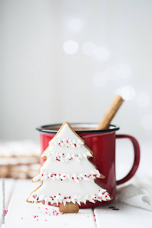 Christmas tree cookie and red enamel mug by Ruth Black for Stocksy United