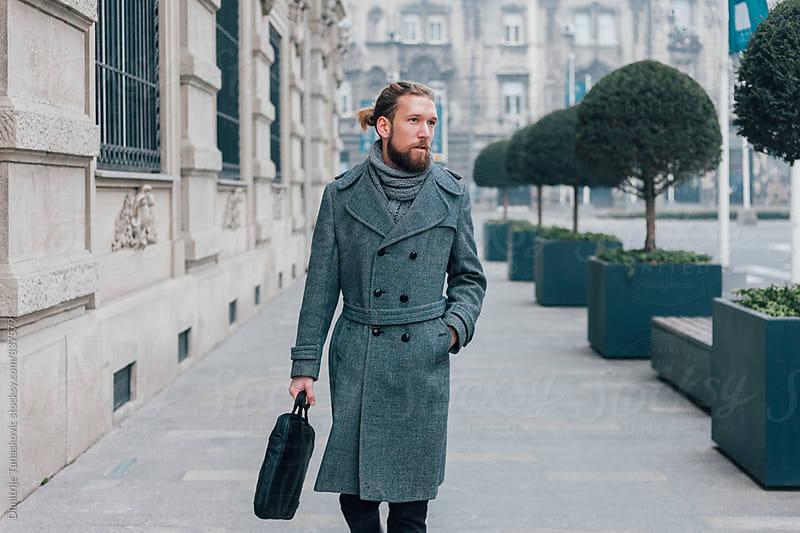 Businessman on the city street by Dimitrije Tanaskovic for Stocksy United