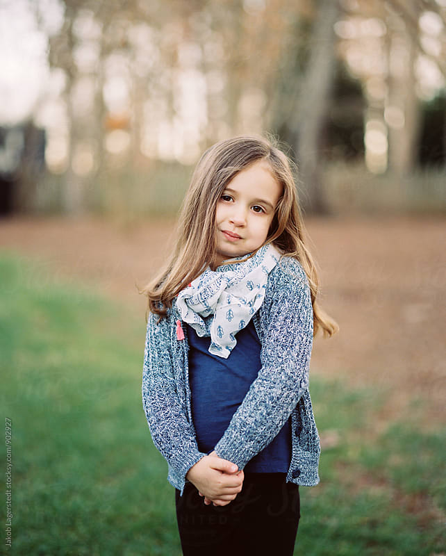 Portrait of a beautiful young girl with a scarf by Jakob for Stocksy United