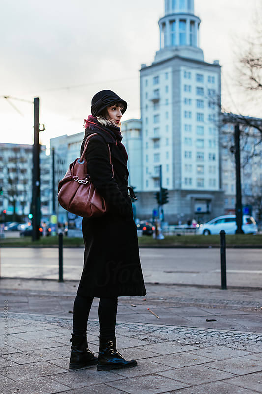 Woman walking on Berlin Streets by Mauro Grigollo for Stocksy United