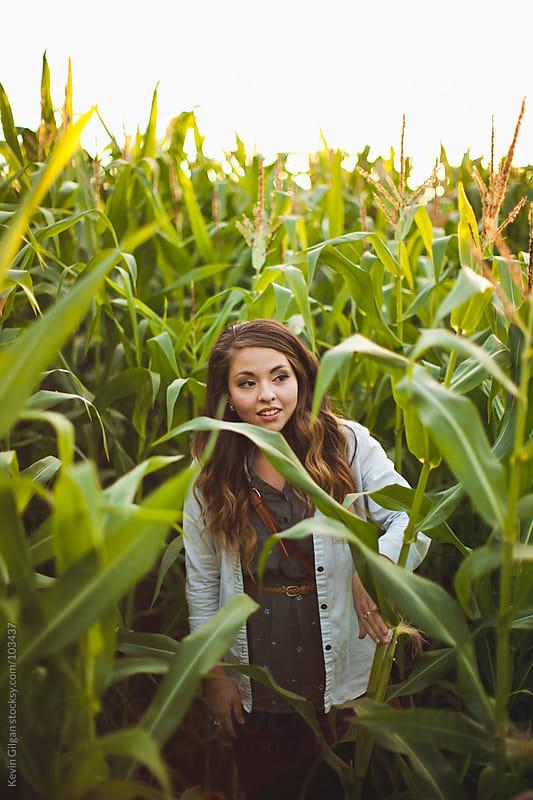 Girl in Corn Maze by Kevin Gilgan for Stocksy United