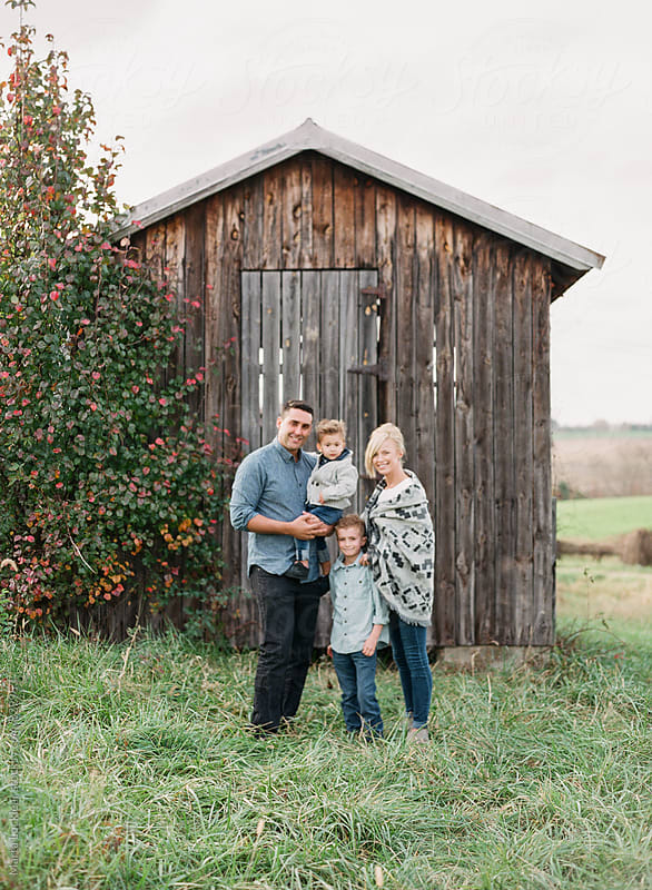 Family Portrait at an old shed by Marta Locklear for Stocksy United