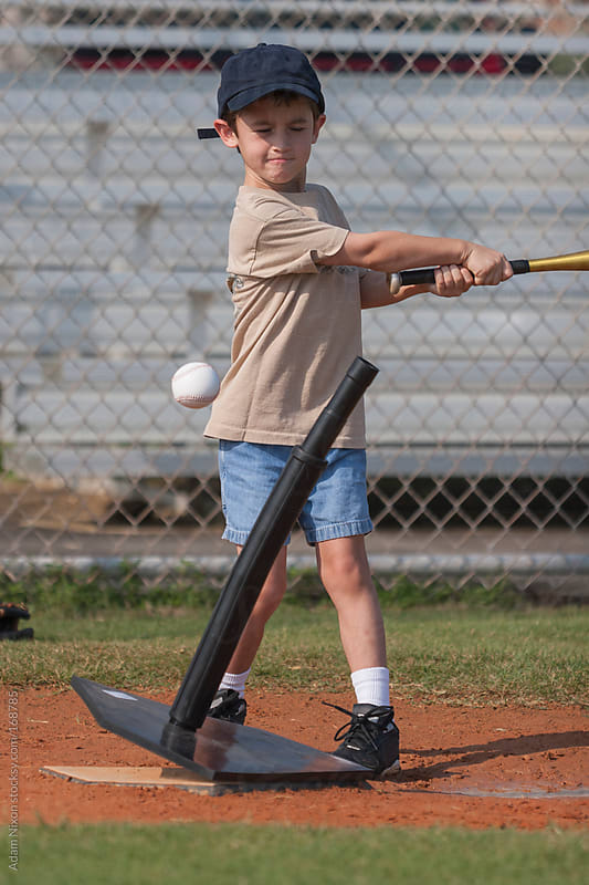 Young Boy Playing Tee Ball by Adam Nixon for Stocksy United