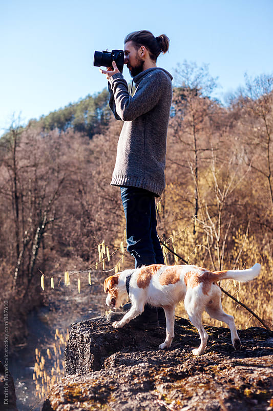 Man taking photos in nature by Dimitrije Tanaskovic for Stocksy United
