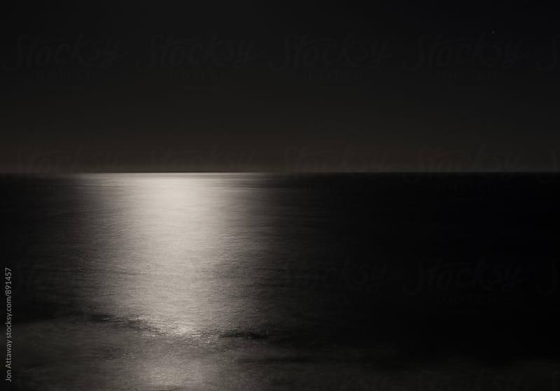 Long exposure of moonlight on an inky black ocean by Jon Attaway for Stocksy United