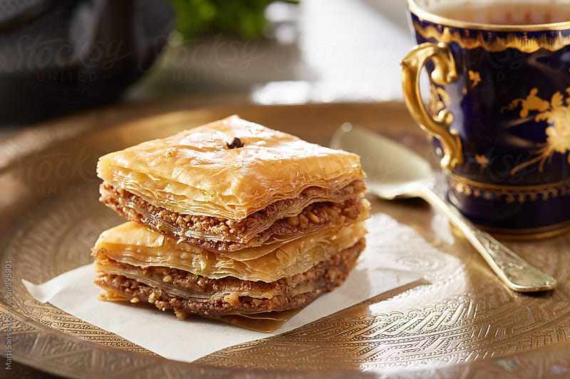 Baklava stuffed with nuts and honey on plate by Martí Sans for Stocksy United