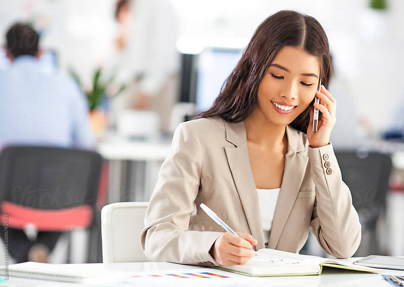 Asian Businesswoman Telephoning by Lumina for Stocksy United