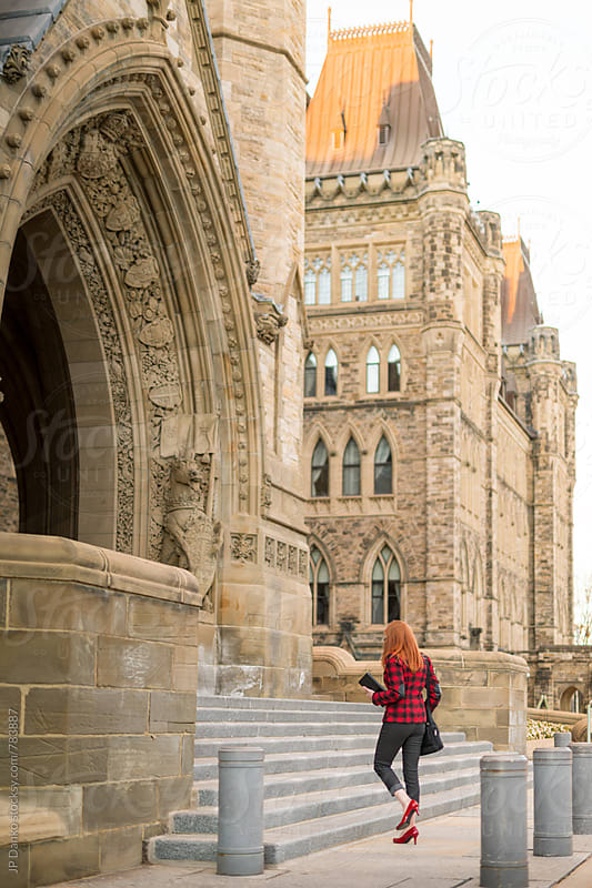 Woman Public Service Worker Going To Work at Parliament Hill Ottawa Canada under Peace Tower by JP Danko for Stocksy United