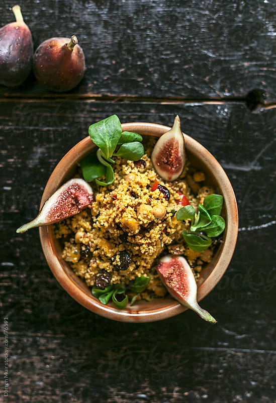 Moroccan couscous with figs. by Darren Muir for Stocksy United
