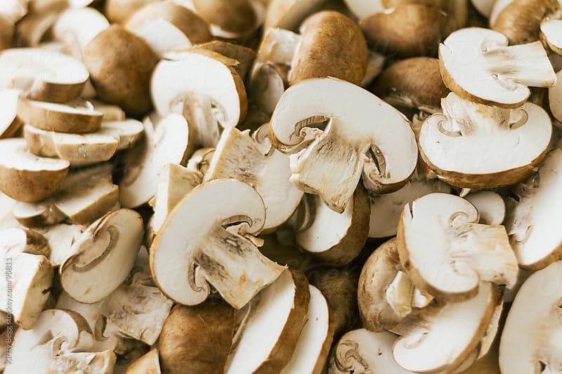 Chopped chestnut mushrooms by Kirsty Begg for Stocksy United