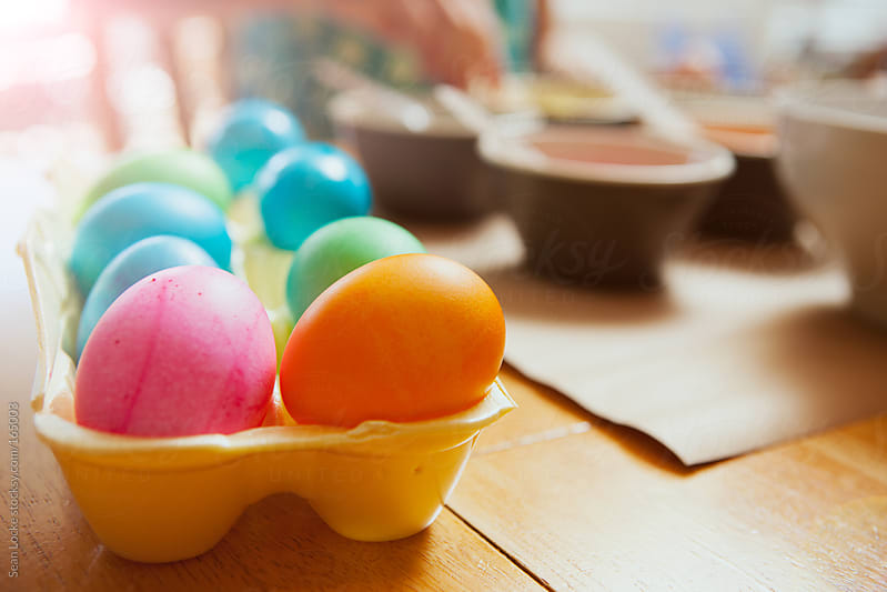 Easter: Egg Carton Holding Colored Eggs by Sean Locke for Stocksy United
