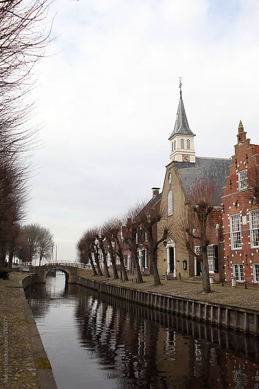 Old Dutch town with a canal by Marcel for Stocksy United
