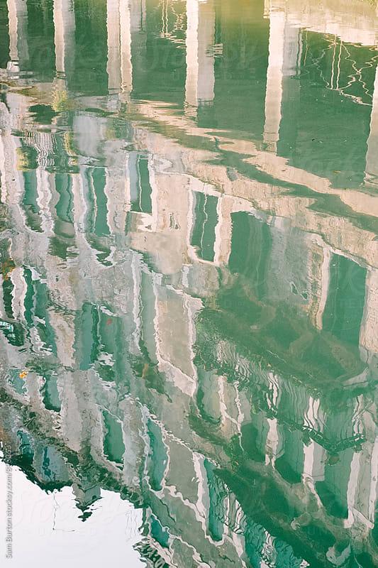 Building reflection by Sam Burton for Stocksy United