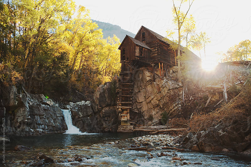 Old Mill With Waterfall by Kevin Russ for Stocksy United