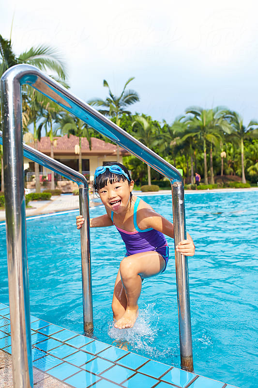 little asian girl in swimming pool by cuiyan Liu for Stocksy United