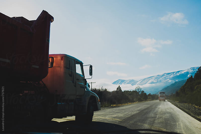 A truck traveling across Patagonia on a sunny day by Leandro Crespi for Stocksy United