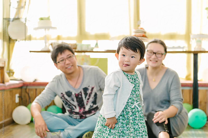 Young father and mother with baby girl by MaaHoo Studio for Stocksy United