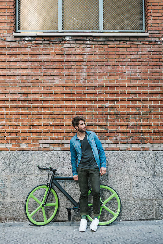 Cool Young Man with Casual Wear Besides a Fixie Bicycle by VICTOR TORRES for Stocksy United