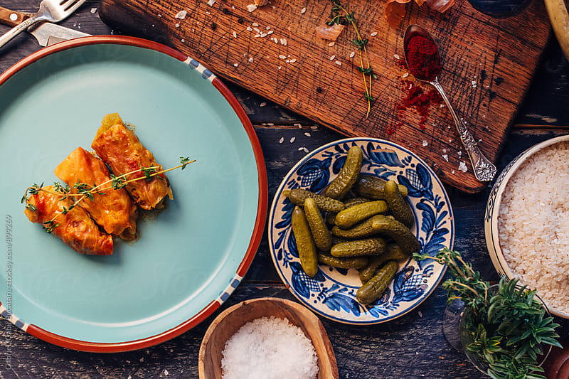 Stuffed cabbage rolls and pickled gherkins from above by Gabriel (Gabi) Bucataru for Stocksy United