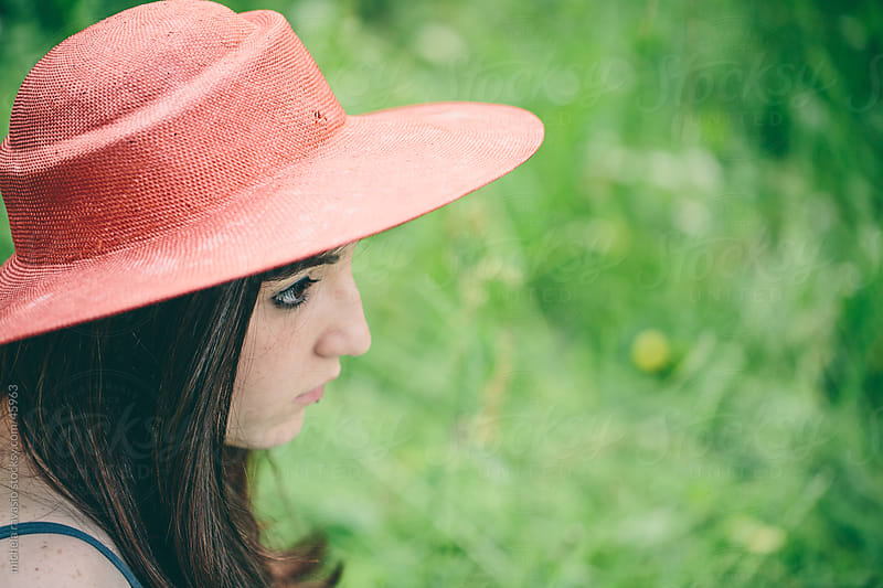 Portrait of a cute girl with red hat by michela ravasio for Stocksy United