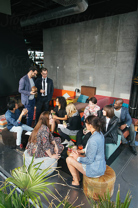 Group of Mixed Race Friends Having Drinks on Sunny Rooftop Bar by Julien L. Balmer for Stocksy United