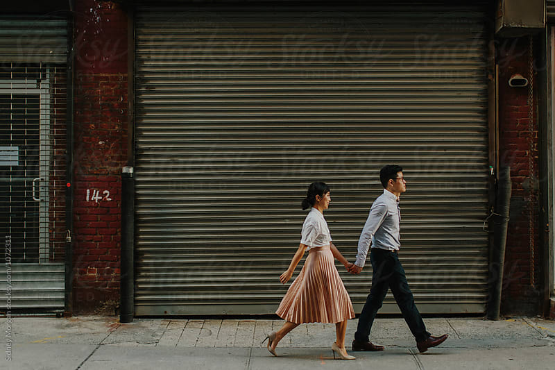 Couple Walking in Industrial Area by Sidney Morgan for Stocksy United